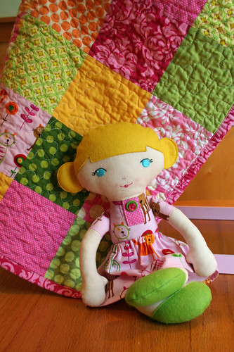 Olivia's doll, quilt, and vintage doll crib