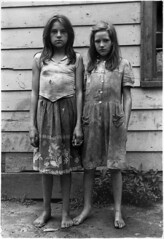 Two girls with dirty clothes holding hands, Kentucky, 1964, by William Gedney