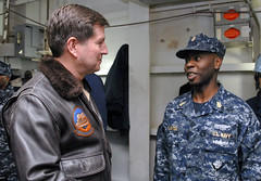 YOKOSUKA, Japan (March 8, 2011) Commander, Naval Air Forces Vice Adm. Allen G. Myers speaks with Senior Chief Aviation Boatswain's mate (Equipment) John Clayton during a visit aboard the nuclear-powered aircraft carrier USS George Washington (CVN 73). (U.S. Navy Photo by Mass Communication Specialist 2nd Class William Pittman/Released)