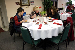 Three Go Red attendees eating and talking at table