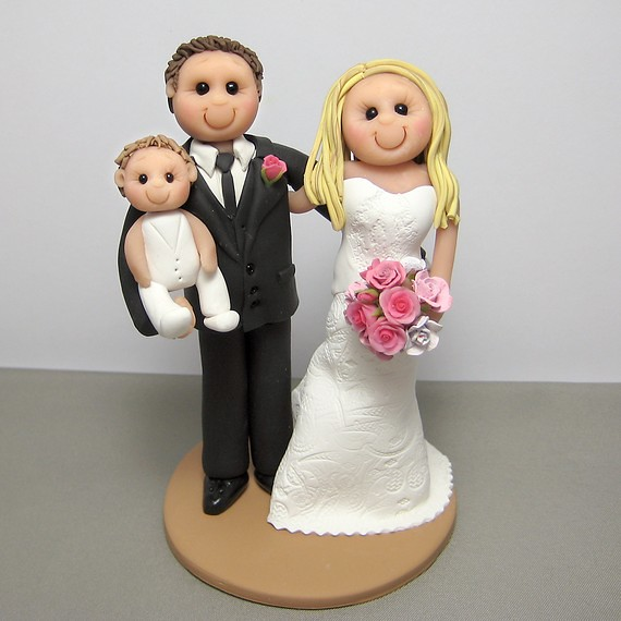Wedding cake topper with bride groom and baby Wedding cake topper