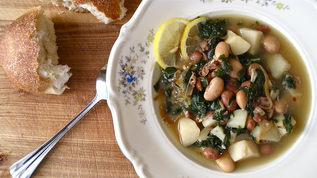 Bean and roasted garlic soup with kale and potatoes