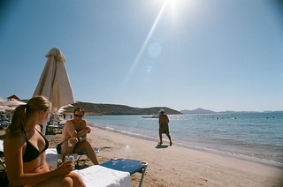 Immagine di Varkiza Beach (Παραλία Βάρκιζας) Beach of Varkiza vicino a Vári. sea sun holiday film beach sand mediterranean glare superia athens greece flare swimmer runner adriatic mediterraneansea 2010 adriaticsea nikonf80 fujisuperia kiril vari ekaterina vouliagmeni varibeach fb:uploaded=true nikkor20mmf28afd vouliagmenibeach athensbeach