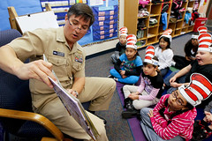 Navy Captain reads to students during Read Across America event.