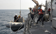 PACIFIC OCEAN (March 13, 2011) Sailors aboard USS John S. McCain (DDG 56) recover a rigid-hull inflatable boat during small boat operations off the coast of Japan. McCain is near the epicenter of the recent earthquake to help search for anyone or anything that might have drifted out to sea. (Photo by Mass Communication Specialist 1st Class Talley Reeve)