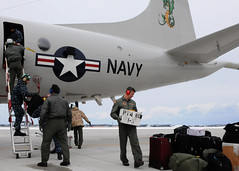 MISAWA, Japan (March 16, 2011) Crew members from Patrol Squadron 4 unload gear upon their arrival at Naval Air Facility Misawa. The squadron has temporarily repositioned in Misawa so it can better expedite relief efforts in Japan. (U.S. Navy photo by Mass Communication Specialist 2nd Class Devon Dow)