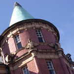 Paragon Hotel - Moseley Street - corner turret with dragons holding shields