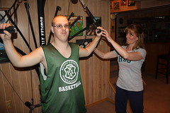 Suzanne Welsh helps Brian Pollack with the Bowflex machine at his home in Merrick, N.Y.