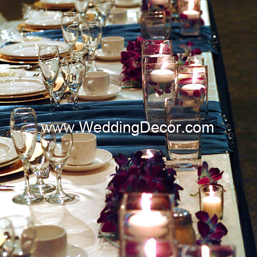 Head table decorations for a wedding reception in turquoise and ivory with
