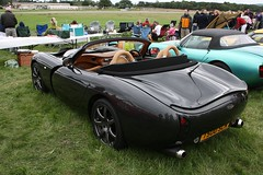 race car(1.0), automobile(1.0), vehicle(1.0), performance car(1.0), automotive design(1.0), tvr tuscan speed 6(1.0), land vehicle(1.0), tvr(1.0), convertible(1.0), supercar(1.0), sports car(1.0),