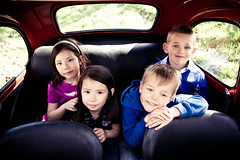 4 kids in the back of a Fiat 500.