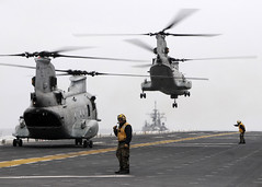 PACIFIC OCEAN (March 21, 2011) CH-46E Sea Knights take off from the flight deck of the forward-deployed amphibious assault ship USS Essex (LHD 2) with humanitarian assistance and disaster relief supplies in support of Operation Tomodachi. (U.S. Navy photo by Mass Communication Specialist 3rd Class Adam M. Bennett)