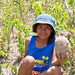 Luz Marina showing off a big yam! by Smaller World Tours