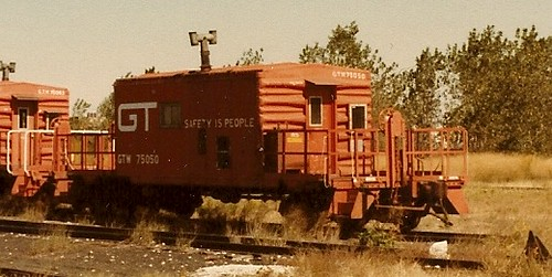A Grand Trunk western Railroad transfer caboose parked just north of adjacent west 51st Street near South St. Louis Avenue. Chicago Illinois USA. October 1983. by Eddie from Chicago