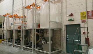 Sistema di estrazione da big bag e trasporto pneumatico