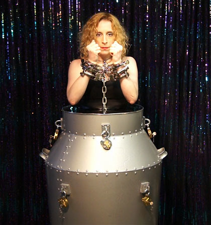 Dayle Krall performing Houdini's Milk Can Escape