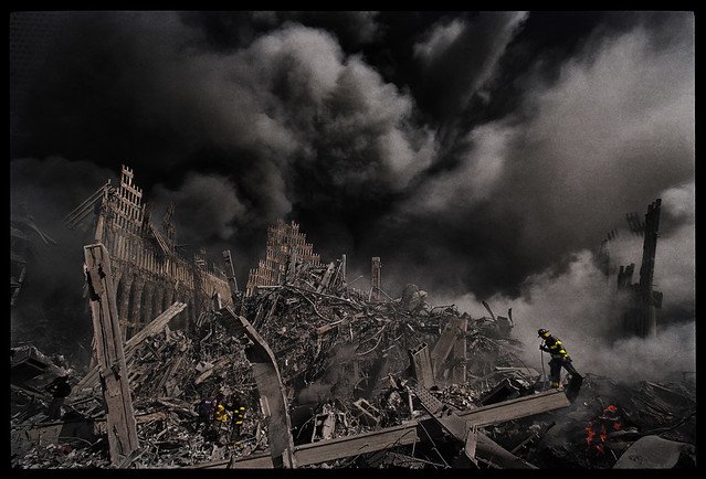 Firefighters search for survivors at ground zero, the site of the collapsed World Trade Center towers in New York, Sept. 11, 2001, by James Nachtwey