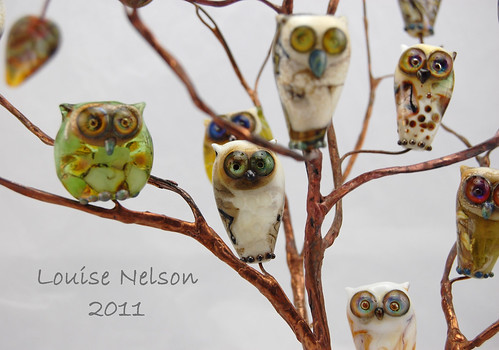 Owl beads 2011 in copper tree by Louise Nelson