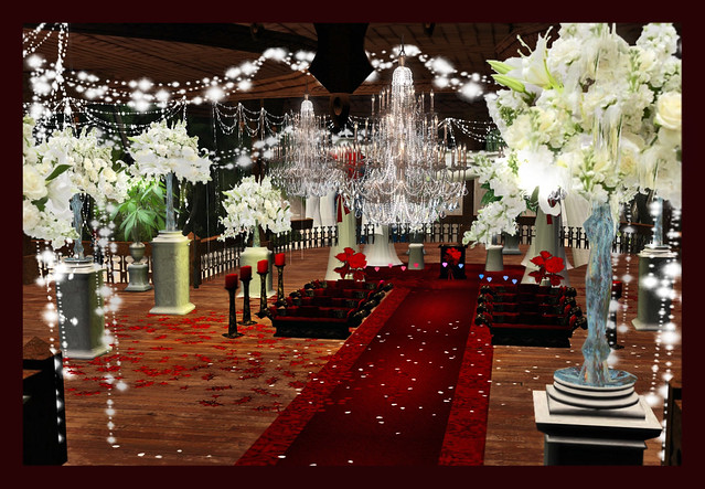 A red black and white wedding decoration in a wooden gazebo