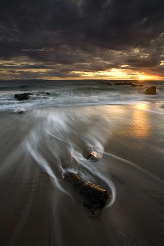 light sunset sun seascape beach canon indonesia landscape flow eos rocks asia cloudy wave filter 5d ang southeast lombok hitech randi senggigi ef1740mmf4lusm