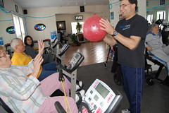 Sal DelGenio tosses a ball around during an exercise class at HOPEFitness in North Bellmore, N.Y.