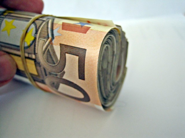 A roll of 50 euro notes from Flickr via Wylio
