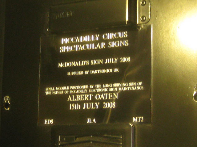 Brass plaque № 7407 - Piccadilly Circus Spectacular Signs  McDonald's Sign July 2008  Supplied by Daktronics UK  Final module positioned by the long serving son of the father of Piccadilly electronic sign maintenance  Albert Oaten  15th July 2008