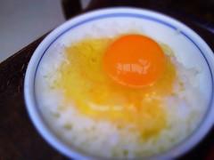 egg(0.0), fried egg(0.0), meal(1.0), breakfast(1.0), steamed rice(1.0), food(1.0), dish(1.0), egg yolk(1.0), cuisine(1.0), asian food(1.0),
