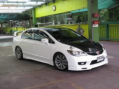 automobile(1.0), automotive exterior(1.0), family car(1.0), wheel(1.0), vehicle(1.0), automotive design(1.0), rim(1.0), honda(1.0), honda civic type r(1.0), compact car(1.0), bumper(1.0), honda civic hybrid(1.0), sedan(1.0), land vehicle(1.0), honda civic(1.0),