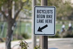 Bicyclists Begin BIke Lane Here