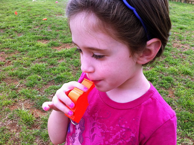 Maggie Trying the Storm Whistle