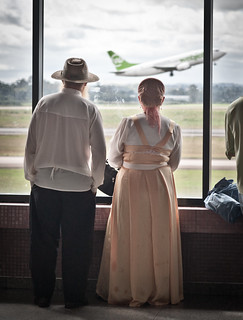 Mennonite couple watching planes, Curitiba airport