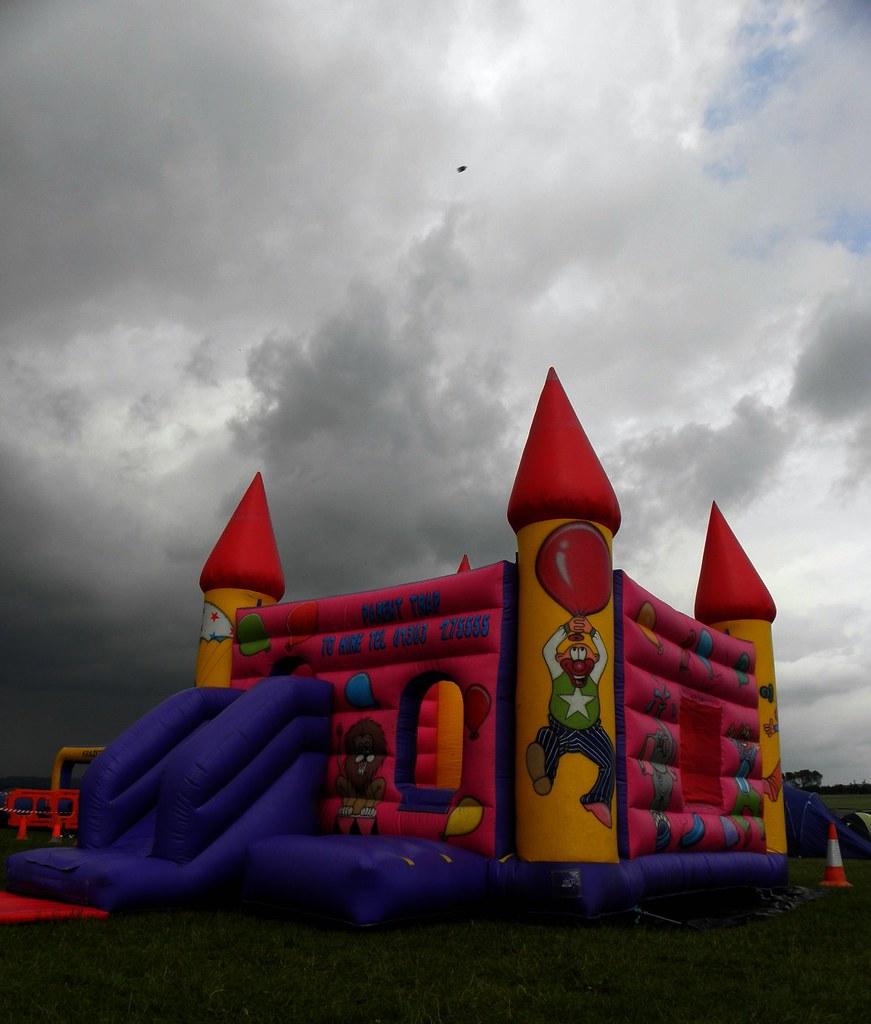 Bouncy castle, child less, against the darkening sky