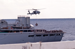 PACIFIC OCEAN (March 26, 2011) -A MH-60S with Helicopter Sea Combat Squadron (HSC) 23 transports cargo from USNS Bridge (T-AOE-10) to the flight deck of USS George Washington (CVN 73) during a vertical replenishment (VERTREP) at sea. (U.S. Navy photo by Mass Communication Specialist 3rd Class Juan M. Pinalez Jr./RELEASED)