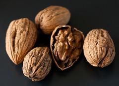 hazelnut(0.0), plant(0.0), fruit(0.0), nuts & seeds(1.0), tree nuts(1.0), produce(1.0), food(1.0), close-up(1.0), nut(1.0), walnut(1.0),