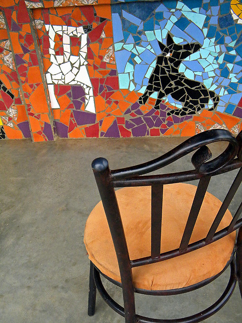 chair in front of mosaic