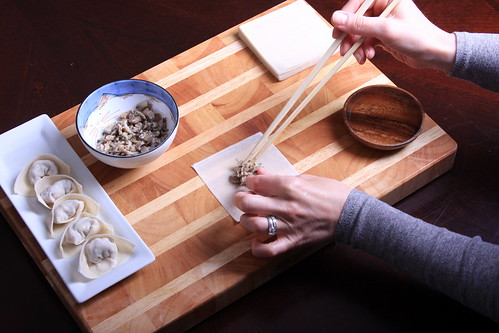 Step Two: Place a teaspoon of filling into the center of the wonton skin.