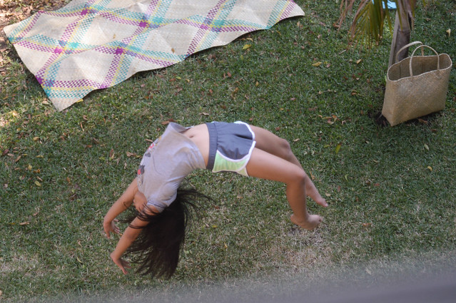 practicing her back handspring in the courtyard