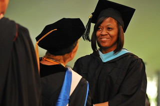 A graduate student receiving her degree