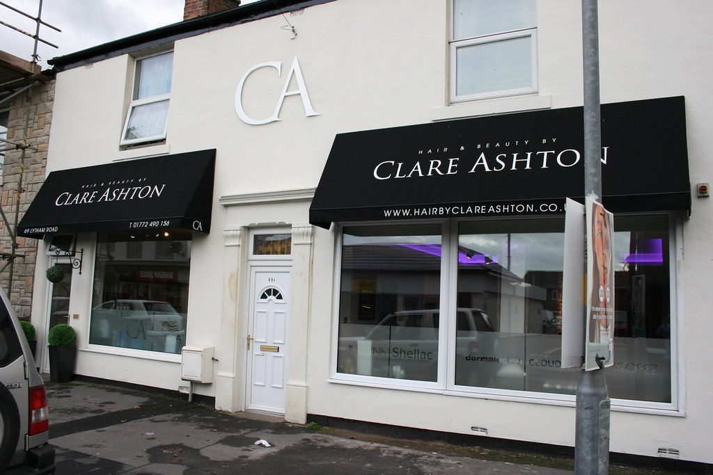 Wedge awnings with printed text, brushed aluminium stand-off letters