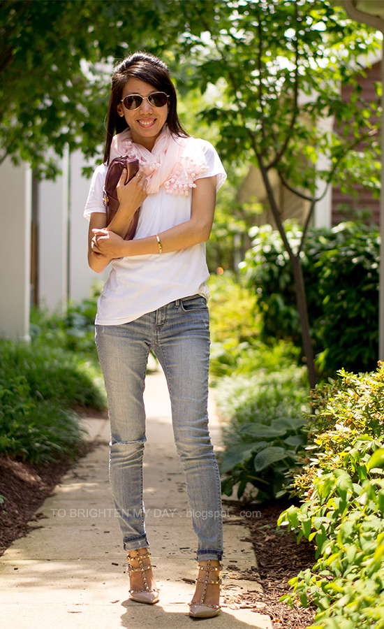 light pink scarf, white tee, metallic rose clutch, distressed jeans, studded heels