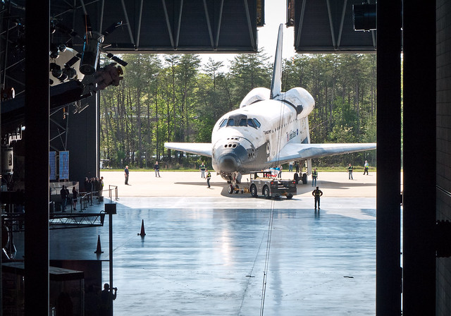 Discovery is slowly maneuvered into position before its permanent move into the McDonnell Space Hangar