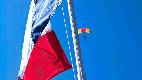 Sky Diver Hides Behind The Flag