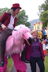 My Sister making a twerp of herself with a stilted man and a giant pink flamingo