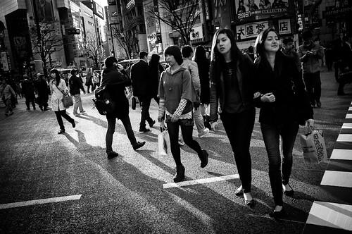 Ladies crossing the street at the crossroads of Shibuya. Tokyo 2012