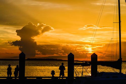 sunset people water silhouette clouds landscape boat unitedstates florida fernandinabeach ameliaisland