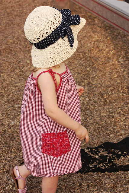 little girl in garden hat
