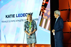 U.S. Secretary of State John Kerry, watches on as Katie Ledecky accepts her award for 'Female Athlete of the Olympic Games' at the U.S. Olympic Committee Team USA Award Show, at Georgetown University, in Washington, D.C. on September 28, 2016. [State Department Photo/ Public Domain]