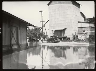 Men observe flooding in Warsaw, Missouri (MSA)