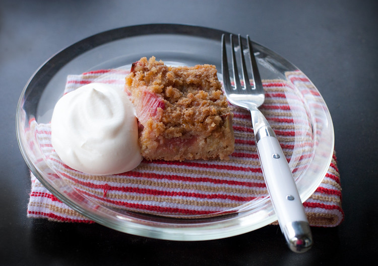 Rhubarb kuchen with a dollop of whipped cream